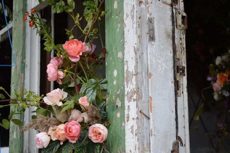 A floral art installation in an abandoned two-story duplex outside of Detroit