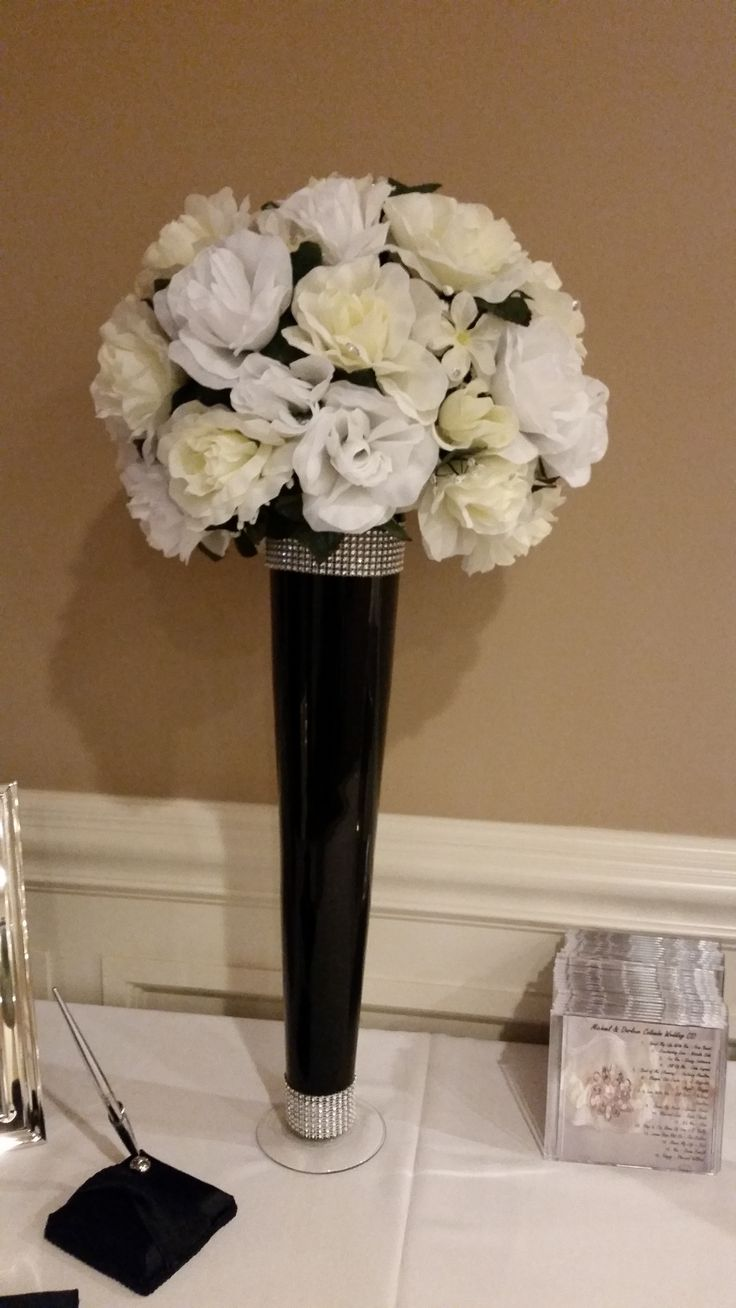 Black white and ivory silk flowers with tall vase