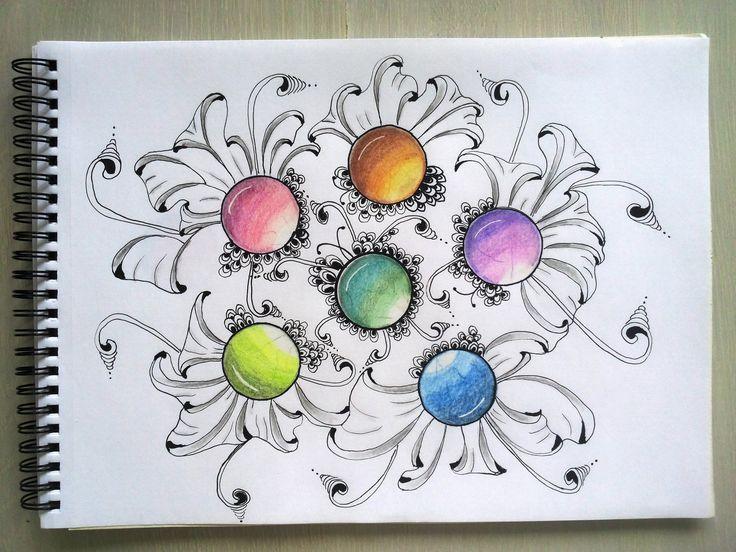 Met aquarel potloden cirkels inkleuren. Daarna met Zentangle pennen met elkaar verbinden.