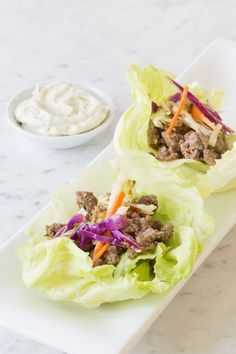 Wasabi Ginger Lettuce Wraps Make in the Square Steamer with Asian Stir-Fry Seasoning and Sesame Ginger Dressing and top with Wasabi Ginger Aioli.
