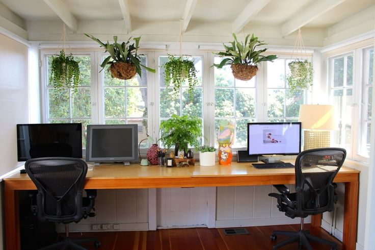 Office Space: This is how to design a home office - desk facing large windows with lots of natural light and plants. I hate when workspaces are cramped in corners or have the desk facing the wall. | Carrie & Hal's Modern Bohemian Home
