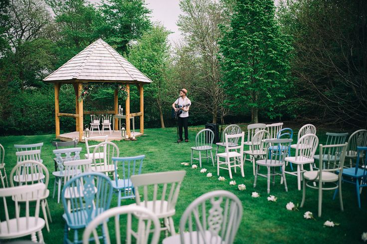 Our outdoor ceremony set up using white and grey chairs with a splash of blue in the stunning lime tree aisle at @cosawesbarton