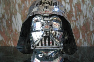Normally we like to leave our beer drinking to after-hours away from the office, but we ran into this article this morning about Japanese artist Macaon transforming everyday beer and soda cans into sculpture art, and we couldn't resist. These are actually quite good, so good in fact, we want to know how much beer was consumed in the making of Darth Vadar?