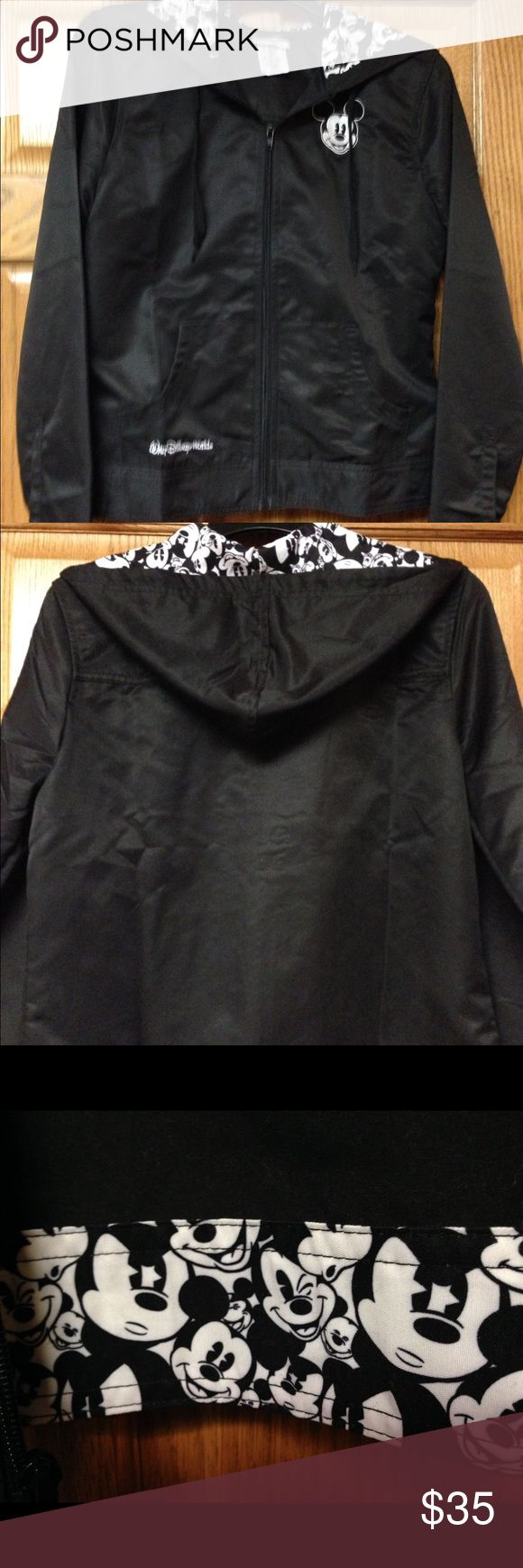 Disney women's rain jacket Super cute Disney rain jacket. Hood and inner band are collages of Mickey Mouse. Mickey Mouse emblem on front too Disney Jackets & Coats
