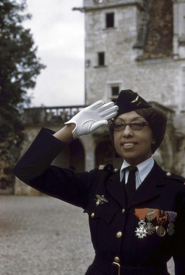 Josephine Baker posing with the military awards granted to her for her work for the French Resistance, ca. 1960, France