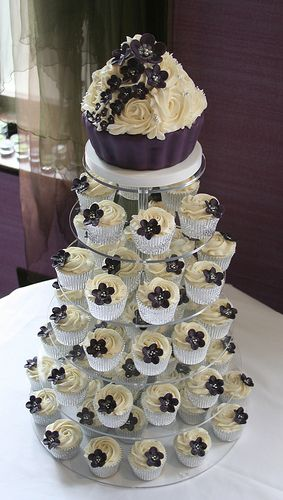 Dark purple wedding cupcake tower by The Clever Little Cupcake Company, via Flickr