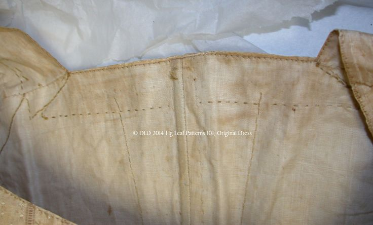 Interior view of the bodice back showing stitches of the facing and should strap on the lining.  Original garment in the collection of the Sumter County Museum, SC.
