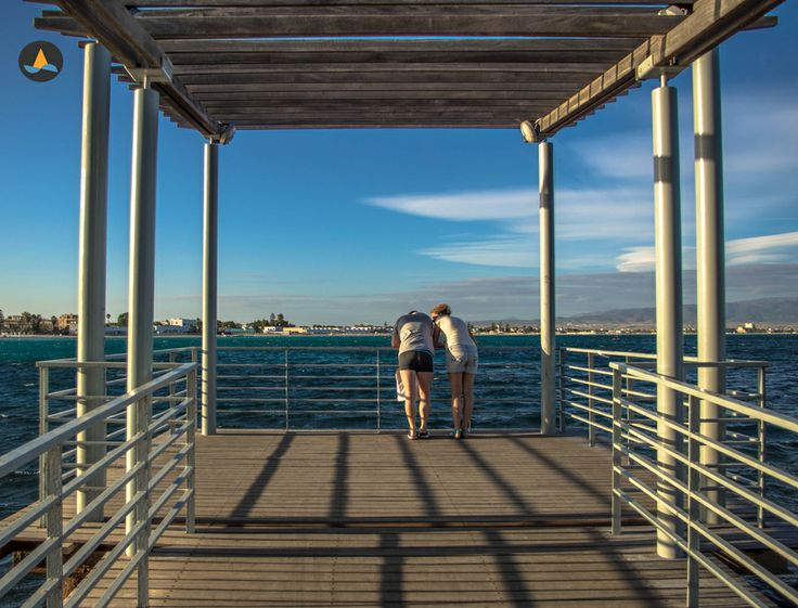 Watching the sea from a pier in Marina piccola.
