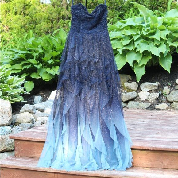 Glitter Midnight Blue Ruffled Strapless Prom Dress Channel the look of a magical starry night for prom or an evening event with this glittery, ombre gown, fashioned with a sweetheart neckline and sheer tiered ruffles. A removable satin self-tie sash is included. Worn only once! Teeze Me Dresses Prom
