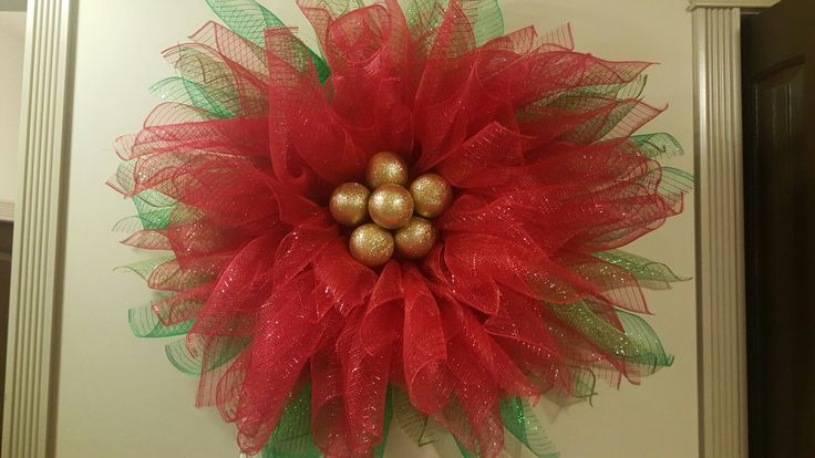 DIY deco mesh poinsettia wreath.  It's easier than I thought and looks beautiful.
