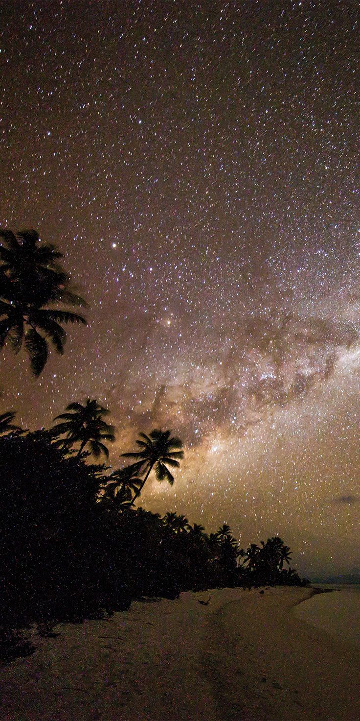 One Foot Island beneath the Milky Way in Aitutaki, Cook Islands - by Sean Scott