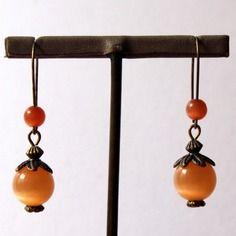 Boucles d'oreilles en métal bronze, perles en verre œil de chat aux reflets changeants orange