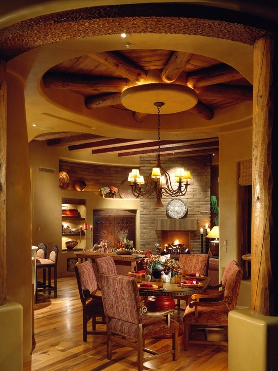 I love the wagon wheel ceiling design i love western for Western dining room ideas