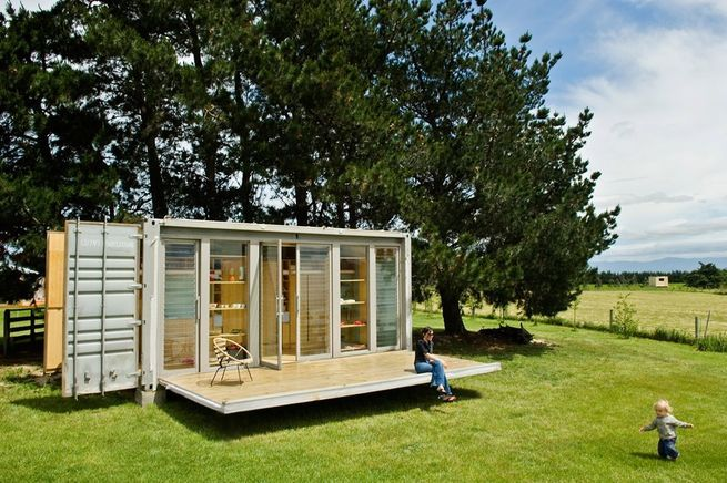 This small shipping container homein New Plymouth, New Zealand, features a retractable porch.
