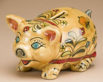 This is a Hand painted Mexican Talavera pottery piggy bank with intricate patterns and brilliant colors. The Talavera ceramic pottery is beautiful and adds life to any setting. This Talavera pig bank