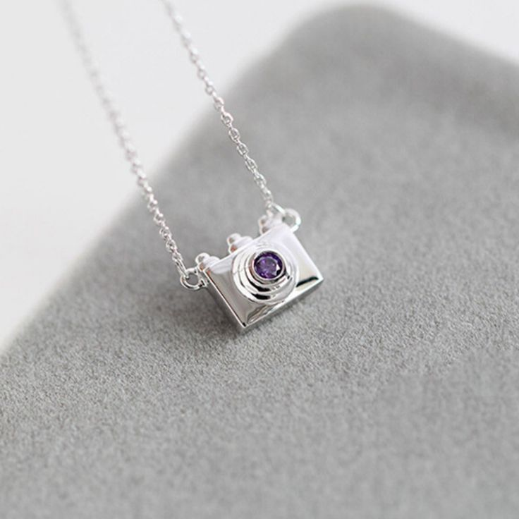 Are you a photographer? Love photography? Then this necklace is perfect for you! An elegant accessory, this dainty camera necklace has a high polished finish for an eye-catching shine. - 2016 New Vers
