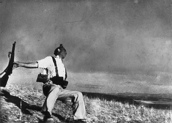 "Robert Capa, 1936  ""Loyalist Militiaman at the Moment of Death"" is the official name of this photograph, which depicts the lapsed second in which a militiaman is shot and, almost in slow motion, falls to the ground. The fallen man is said to be Federico Borrell Garcia, a Spanish Republican and anarchist soldier in the Spanish Civil War."