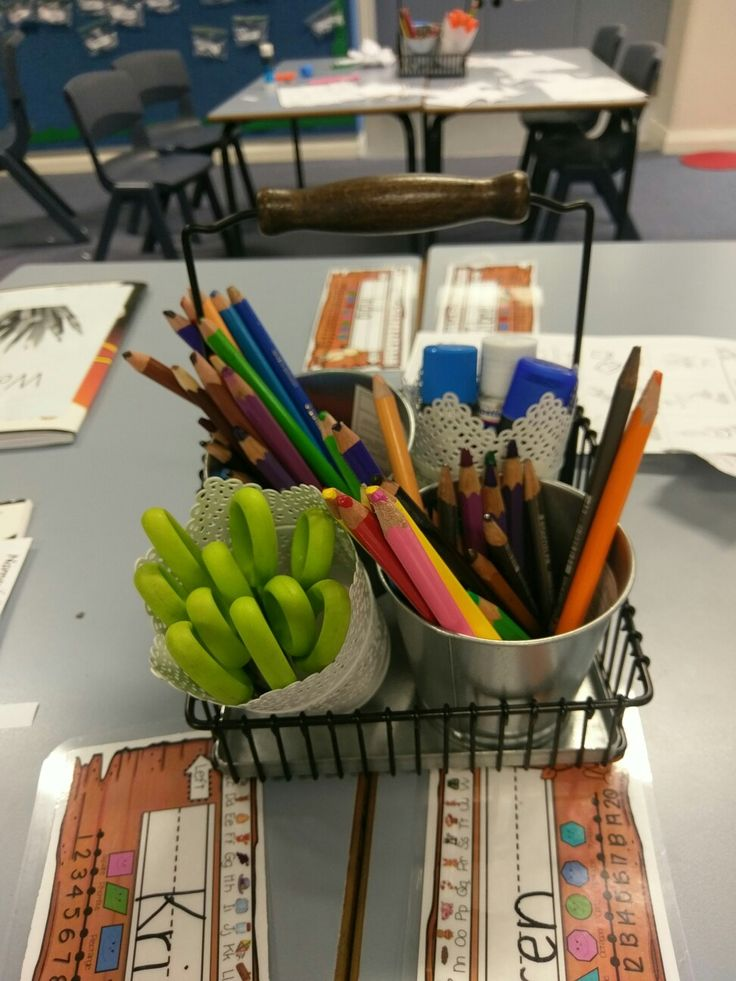Ikea made pencil caddies with  flower pot tins