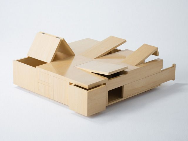 The Kai Puzzle Box Table is inspired by traditional Japanese puzzle boxes to open up revealing a series of storage spaces.