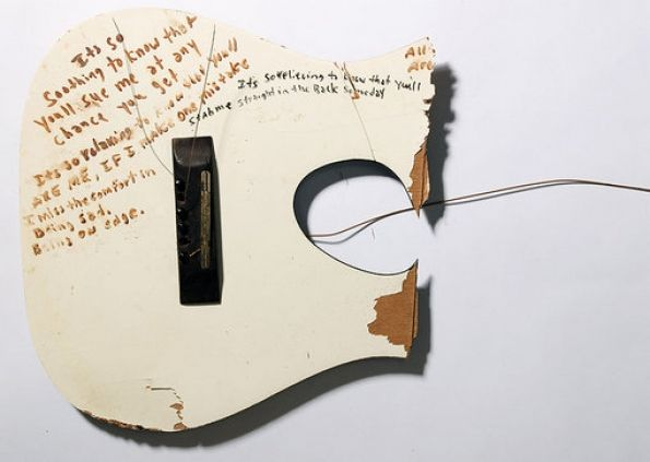"""Kurt Cobain's broken guitar, with the lyrics to """"Frances Farmer Will Have Her Revenge on Seattle"""" (one of my favorites), written on the body (via Rolling Stone)"""