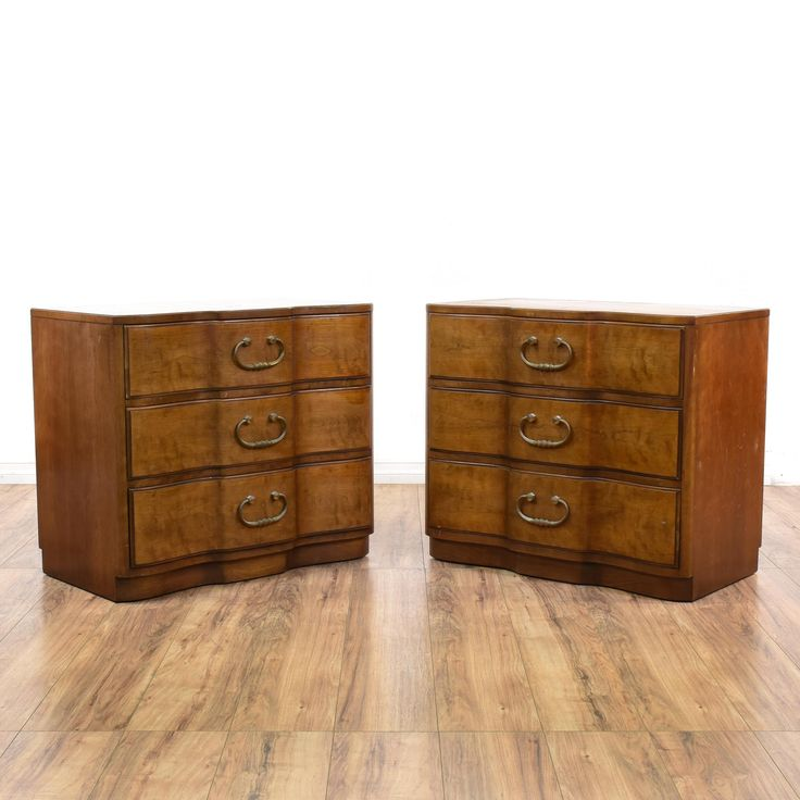 "This pair of ""Henredon"" chest of drawers are featured in a solid wood with a glossy walnut finish. These short dressers have curved fold fronts, 3 spacious drawers and antique brass pulls. Perfect storage pieces to use as large nightstands!  #americantraditional #dressers #chestofdrawers #sandiegovintage #vintagefurniture"