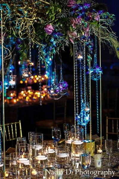 This Indian wedding reception is decked out in whimsical florals and a luminous blue glow.