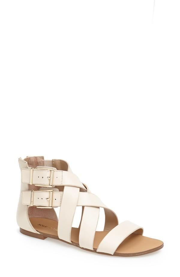 Channeling the Roman Goddess within by wearing these strappy leather sandals.