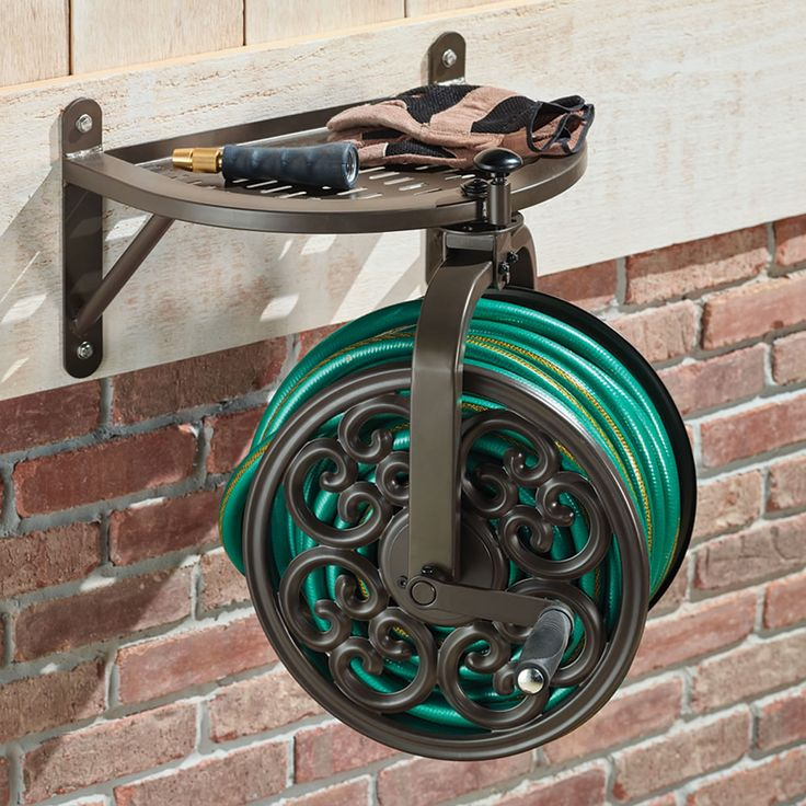 25 best ideas about hose reel on pinterest the shanty for Garden hose solutions