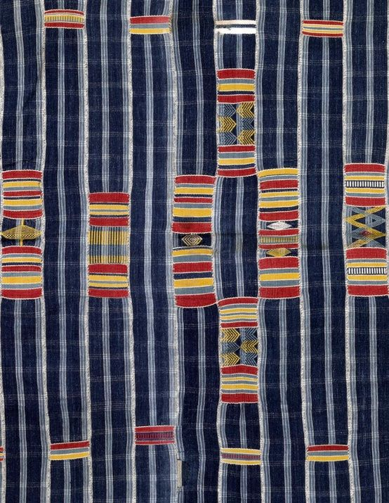 Africa | Detail from a rare men's hand spun cotton wrapper cloth from the Bondoukou area, north east part of the Ivory Coast llustrates two of the distinctive aspects of pattern layout within this tradition that differ from those of the Asante and Ewe in Ghana, namely a focus on the centre of the fabric and an alignment of patterns in rows down the cloth (rather than the chequerboard type layout typical in Ghana.) | ca. 1900
