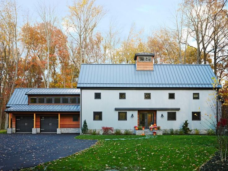 """Working with Bennett Frank McCarthy Architects, John built a 4,000-square-foot modern farmhouse in Ramsey, NJ, that's equally inspired by his love of contemporary architecture and Jennifer's fondness for old barns. """"We wanted people to look at our home and wonder, Was this always there?"""" he says. The exterior features a mix of corrugated steel and ipe wood to look like a barn that's been updated over time. Inside, the house showcases all the design ideas John champions on his shows, like…"""
