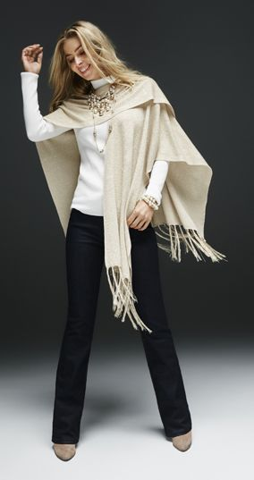 Top off your outfit with this shimmery gold wrap. A sparkly woven pattern and silky fringe give it a luxe look.