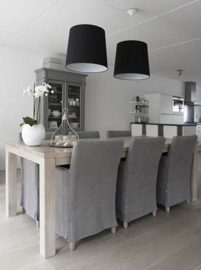 Grey Linen Slipcovered Dining Chairs And Palest Blonde Woods In A Pretty White Kitchen