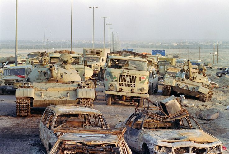 A long line of vehicles including destroyed Iraqi Army Russian-made T-62 tanks and trucks stand abandoned by fleeing Iraqi troops on the outskirts of Kuwait City on March 1 1991; Pascal Guyot [1500 x 1009]