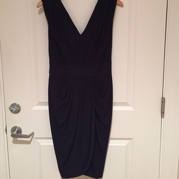 Navy Blue Cocktail Dress by Suzi Chin Navy Blue cocktail dress by Suzi Chin for Maggy Boutique. Thick sleeves and v neck front and back. Ruching in the middle makes for flattering lines. Wrap like effect in the front. Back zipper. Worn once and in excellent condition! Suzi Chin for Maggy Boutique Dresses
