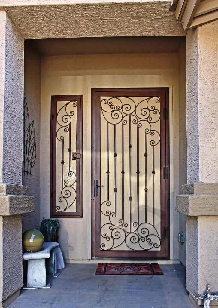 Top 25 ideas about decorative metal security for windows for Decorative entrance doors
