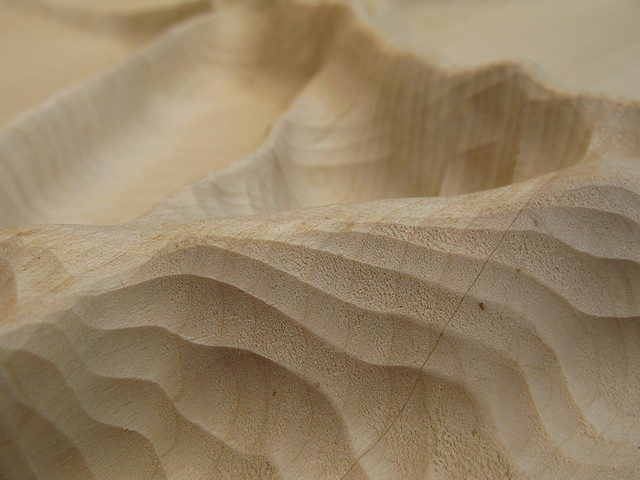 Wind data made 3D by CNCing into a block of wood.