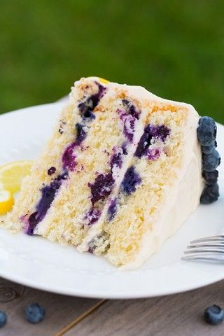 Lemon Blueberry Cake This cake is amazing. Favorite part is the frosting where the lemon was placed for decor.