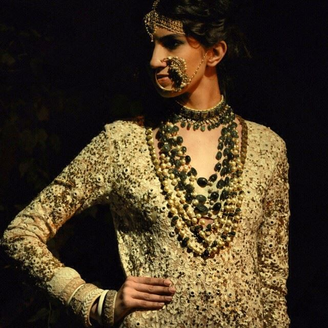 Layering is not just a winter thing to keep warm, its a new must with accessories bringing that regal glam feel