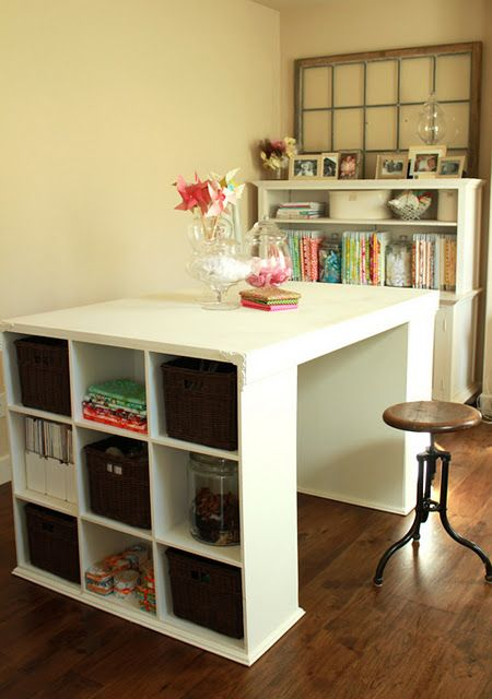 Two small bookshelves plus a thick board (painted white). Awesome crafting table! Jenni, I thought you might get an idea out of this.