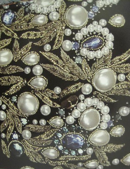 Pearl beading with feather embroidery