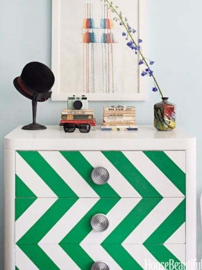"Designer Nick Olsen amped up a Brooklyn studio apartment — just 295 square feet — by painting a flea-market chest in shiny white Rust-Oleum, with an emerald green chevron pattern. ""My motto is, 'Don't be afraid to paint,'"" he says. 