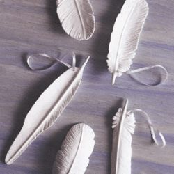 Get this look for a fraction of the cost-how to make a feather pendant out of clay.