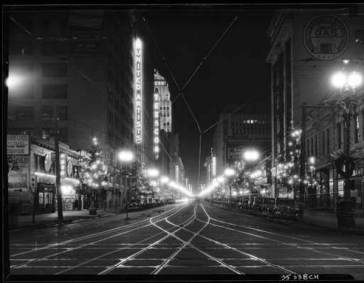 Broadway looking north-east from 10th Street (now, Olympic Boulevard), showing Christmas decorations along the sides of the street, December 1930 :: California Historical Society Collection, 1860-1960