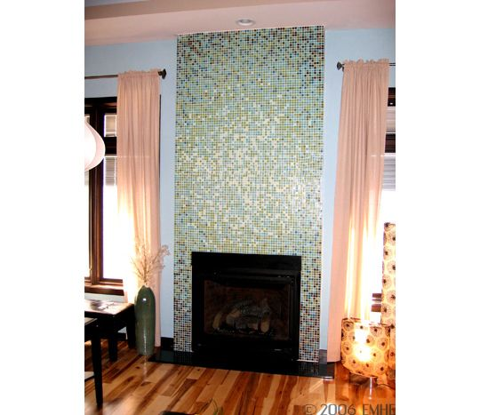 Floor to ceiling glass tiles.  Pricey but elegant.