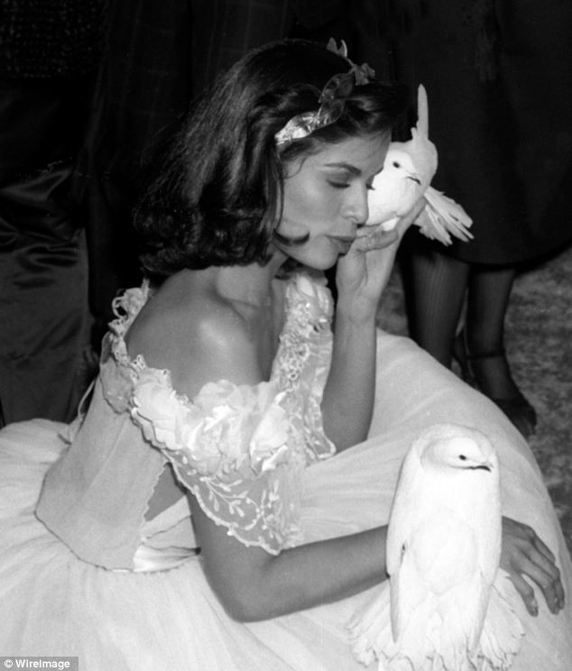 Inside Studio 54: Bianca Jagger, ex-wife of Rolling Stone Mick Jagger, pictured with two white doves at party held in her honour on December 12, 1977. For her 30th birthday she famously rode out into the club atop of a white horse
