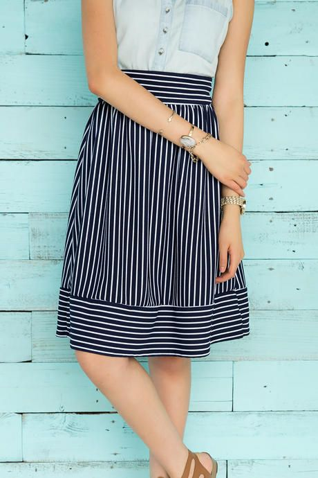 "Swing into summer with the Alyce Striped Midi Skirt. This a-line skirt boasts navy & white stripes with an exposed zipper at the back. Style with a chambray tank or a white blouse for a polished look.<br /> <br /> - 26"" length<br /> - 28"" waist<br /> - 33"" sweep<br /> - measured from a size small<br /> <br /> - 95% Polyester, 5% Spandex<br /> - Hand Wash<br /> - Made in U.S.A."