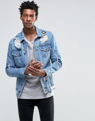 Always Rare - Giacca di jeans molto consumata con strappi rattoppati e toppe