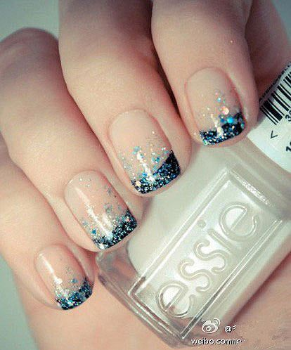 Beautiful french tip nails with gradient glitter. Perfect for a special occasion.