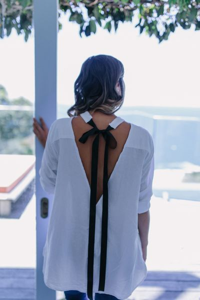 Give an ordinary white button up a makeover with this chic Tie Neck Top DIY!