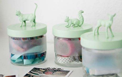Give old jars a new look. Use small animal figures, glue them to the top and add a fresh coat of paint. Voila!